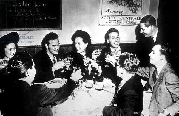 Marcel Cerdan at restaurant Le Bistrot in Paris with Mrs Jo Longman, Mrs Maud O'Connor Janet , harles Trenet, Robert Allembert , Jacques Pills, Jo Longman et Harris Seguela c. 1948