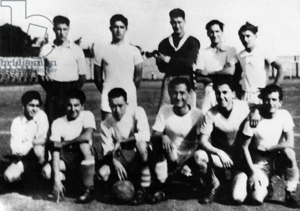 French writer Albert Camus (1913-1960) with ballon, in his football team, Algiers, 1937