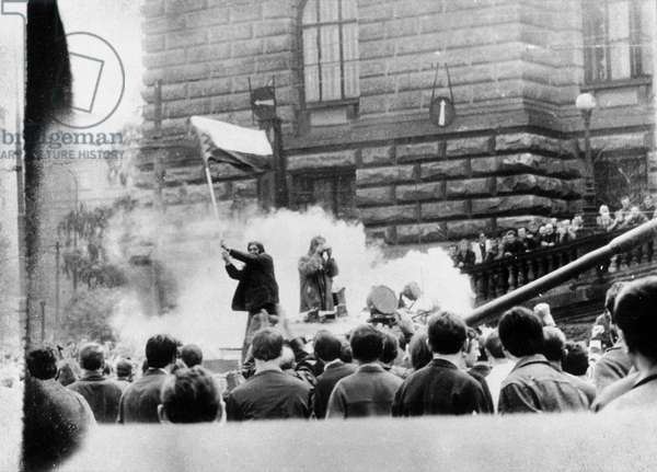 A Czech Student on a Russian Tank, waving a flag, Prague Spring, 1968 (b/w photo)