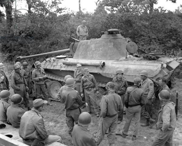 American P47 unit taking stock of the situation around distroyed Panther tank during the Battle of Normandy july 19, 1944, a month after the Allied landings
