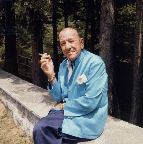 Sir Noel Coward smoking