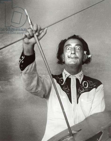 Salvador Dali holding paint