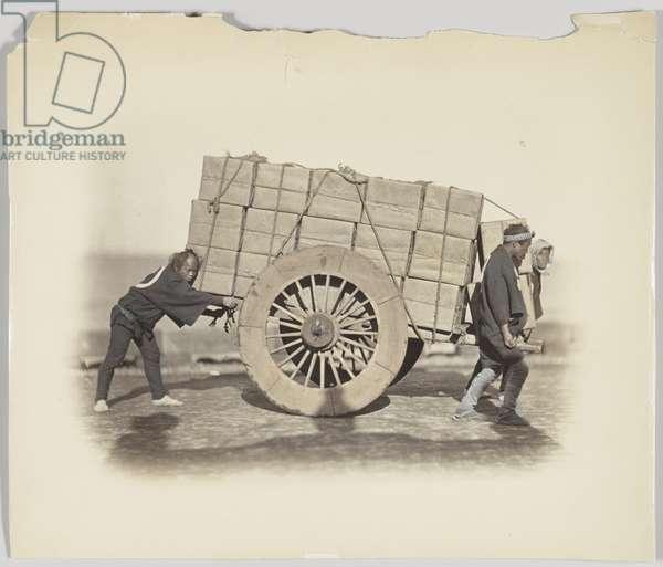 Men hauling a cart (hand-coloured b/w photo)