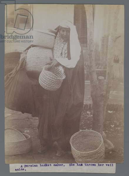 Woman carrying baskets with veil thrown aside (silver albumen photo)