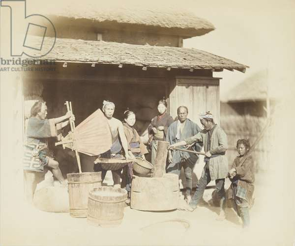 Rice-husking in Japan (hand-coloured b/w photo)