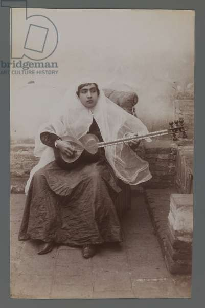 Woman seated playing a six-string Persian lute (silver albumen photo)