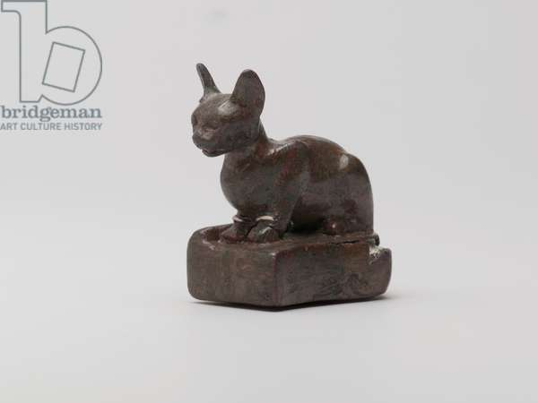 Small figure of a cat wearing one earring and one necklace, Saqqara, Egypt (bronze, silver & lead)