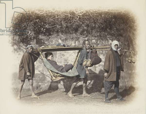 Woman carried in a kago (hand-coloured b/w photo)