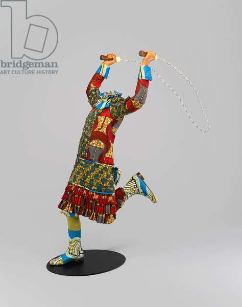 """Skipping Girl, from a series of 7 mannequins titled """"Mother and Father Worked Hard So I Can Play"""", 2009 (life-size fiberglass mannequin, Dutch wax printed cotton, mixed media)"""