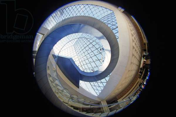 The pyramid of the Louvre in Paris seen at the fisheye