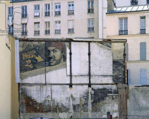 Wall painting of a Parisian facade, between the Quai de la Loire and Avenue Jean Jaures, Paris 19th. Photography 1993.