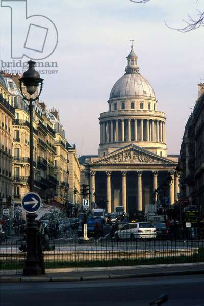 The Pantheon in Paris. Construction 1757-1790, architect Jacques Germain Soufflot (1713-1780). In 1744 Louis XV, suffering from a serious illness in Metz, would wish to erect an immense church instead of the abbey of Sainte Genevieve, which was then in ruins. When the war came, he kept his word and assigned the architect Soufflot the task of drawing the plans of the monument. A great admirer of Greek Roman architecture, he imagined a gigantic building, built on a plan of Greek cross 110 metres long, 84 metres wide and 83 metres high. At the time, the project seemed so insane that many, in the court and in the salons of the capital, would question Soufflot's abilities and prevent the collapse of the monument. Louis XV confirmed his confidence in the architect and laid the foundation stone in 1764 during a grand ceremony. In 1806, the Pantheon, like all the churches in France closed during the revolution, was restored to its original name of Sainte Genevieve church. Renamed Pantheon in 1830, the building regained its vocation as a laique and patriotic temple. Headquarters to the insurgents of the Commune in 1871, during which Milliere was shot on the steps, the building was definitively transformed into a Republican monument in 1885, during the funeral of Victor Hugo.