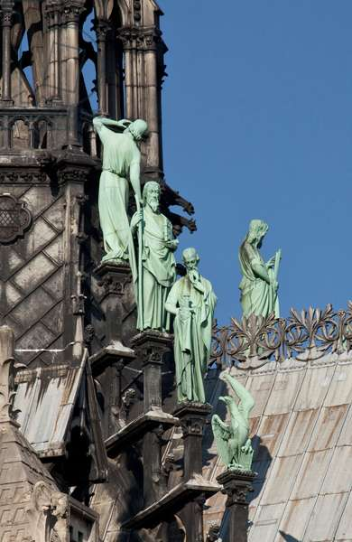 The statues of the saints adorning the base of the arrow of the cathedrale Notre Dame de Paris