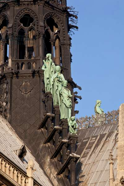 The statues of Christ and the saints adorning the base of the arrow of the cathedrale Notre Dame de Paris