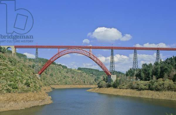 The Garabit viaduct (rail bridge) in the Cantal in Auvergne (France) crosses the waters of the dam's reservoir lake. Architecture by Gustave Eiffel, 1881-1884.