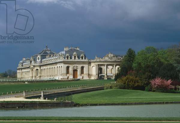 Les Grandes Ecuries du chateau de Chantilly, Oise, Picardie, France. Louis-Henri, Prince of Bourbon-Conde, premier of Louis XV from 1723 to 1726, had Jean Aubert built the Grandes stables, an architectural masterpiece of the 18th century. The Stables and the Saint Antoine Gate