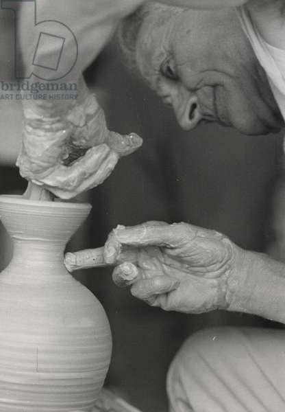 Untitled [Michael Cardew shaping a ceramic pot], 1968 (b/w photo)