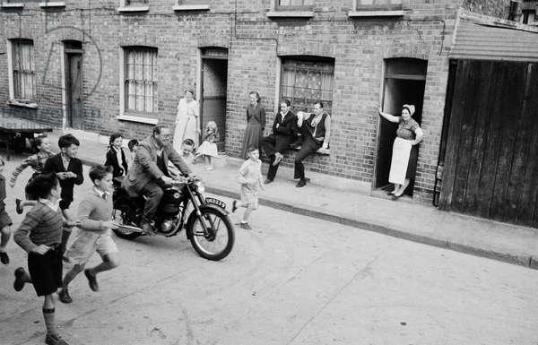 Supervisor Harry Killick on his way to unlock the gates of the Lollard Adventure Playground, Lambeth, South London, 1955 (b/w photo)