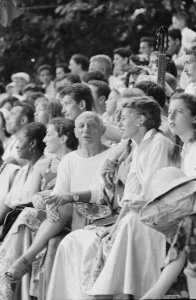 Pablo Picasso at bullfight in Vallauris, France, 1955 (b/w photo)