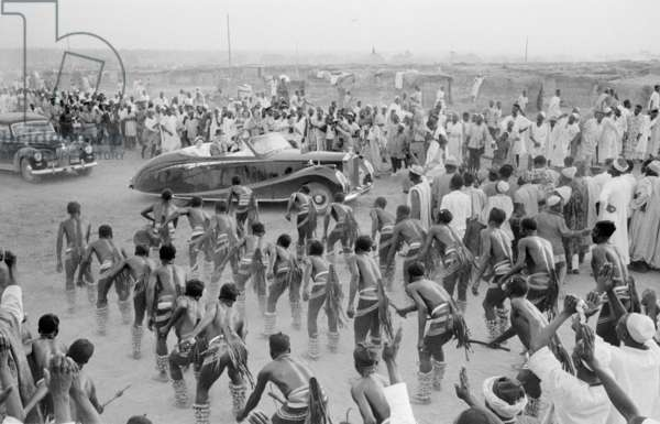 Dance in honour of Queen Elizabeth II and the Duke of Edinburgh on royal tour in Kaduna, Nigeria, 1955 (b/w photo)