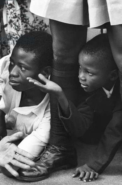 Boys waiting to see Queen Elizabeth II at a Myohaung Day service in Lagos Cathedral, Nigeria, 1956 (b/w photo)