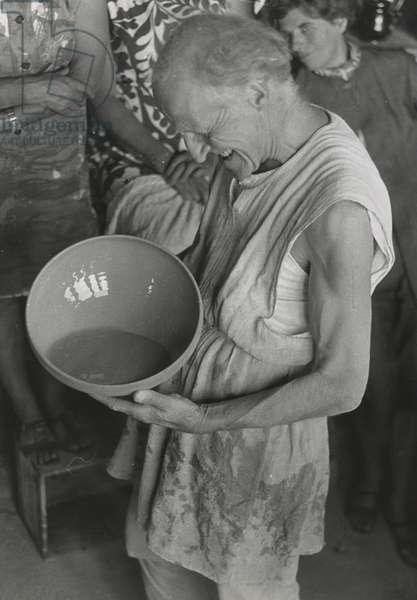 Untitled [Michael Cardew with glazed bowl], 1968 (b/w photo)