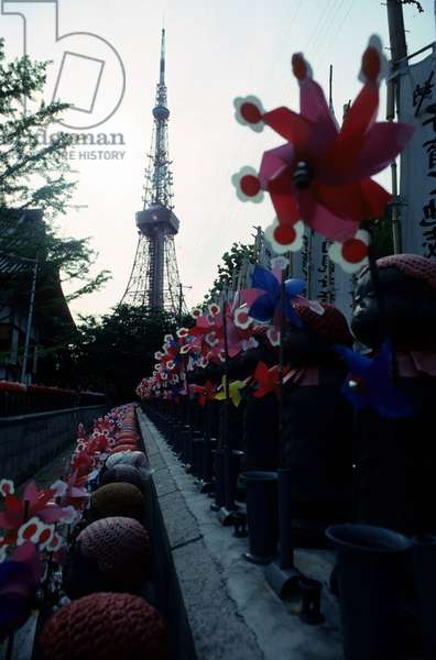 Japanese custom in Tokyo (Japan) and reproduction of the Eiffel Tower.