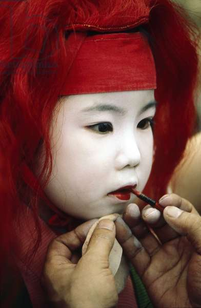 KYOTO: Make-up of a child for a folk party.