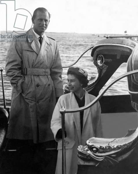 HM The Queen and The Duke of Edinburgh, seen as they return in the royal barge to the Britannia after lunching informally with the Duke and Duchess of Palmela yesterday, They sail in the Britannia to Lisbon this morning to start their State visit to Portugal, 18th February 1957 (b/w photo)