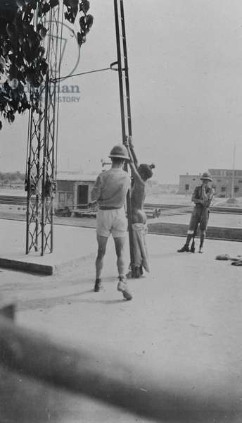 In the wake of the Amritsar massacre and the attack on Miss Marcella Sherwood, General Dyer erected a flogging booth in the middle of the lane where Miss Sherwood fell, manned by British troops to punish locals, April 1919 (b/w photo)