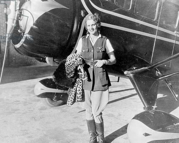 Aloha Wanderwell at Roosevelt aerodrome in Long Island, New York, 1934 (b/w photo)