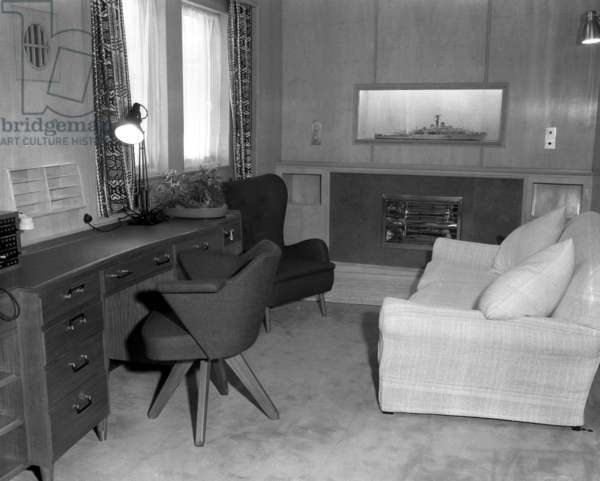 The Duke of Edinburgh's sitting room, note the model of HMS Magpie, the frigate the Duke commanded, HM Yacht Britannia, 16 May 1954 (b/w photo)
