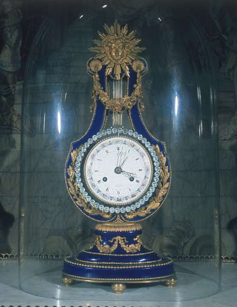 Lyre-shaped mantel clock, by Kinable, case of Sevres porcelain with ormolu mounts, painted enamel dial, Paris, c.1790