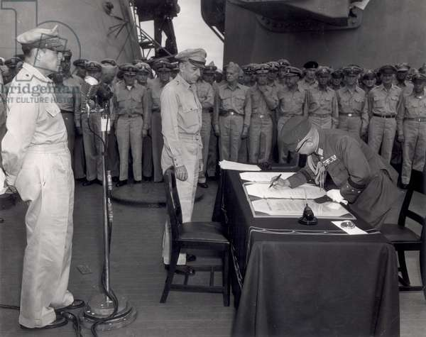 General Yoshira Umeza signs the surrender document 31st August 1945, (b/w photo)