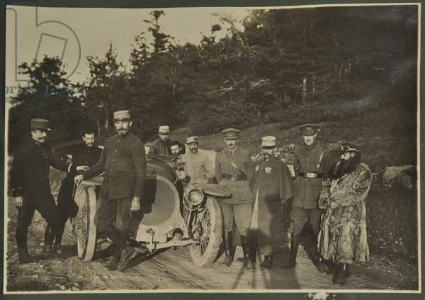 William Lawrence Bragg and Harold Roper as part of a group with a motorcar on a mountain road, Vosges, 1915 (b/w photo)