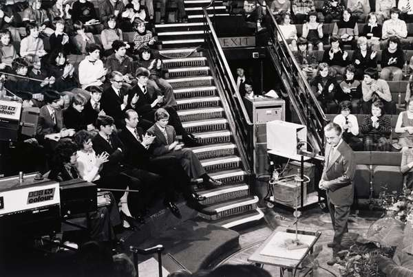 George Porter (1920-2002) Delivering the Christmas Lectures at the Royal Institution, 1976-77 season, with Lady Porter, Prince Andrew, the Duke of Kent and the Earl of St. Andrews in the front row, 1976 (b/w photo)