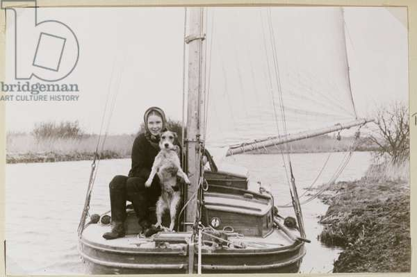 Patience Bragg and her dog on a boat (b/w photo)
