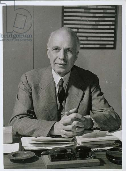 William Lawrence Bragg (1890-1971) in his office at the Cavendish Laboratory (b/w photo)