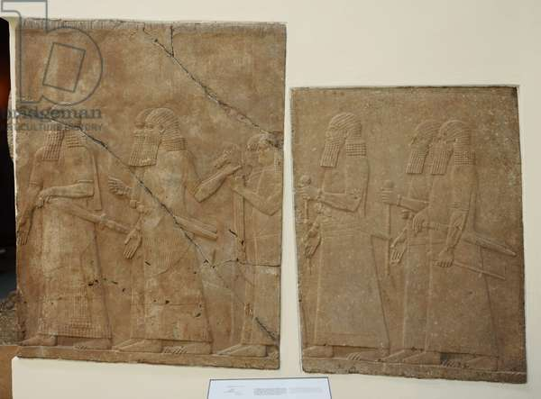 Mesopotamian art. Assyrian. Orthostates with reliefs in the side walls of a ramp from the Palace of Nineveh. Alabaster. 704-689 B.C. It shows Assyrian officers and courtiers carrying a mobile throne. Pergamon Museum. Berlin. Germany.