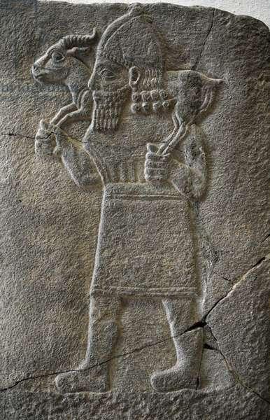 Hittite art. Orthostat. 8th century BC. Relief: Man carrying a gazelle.  Old city of Sma'al /Zincirli (Turkey).