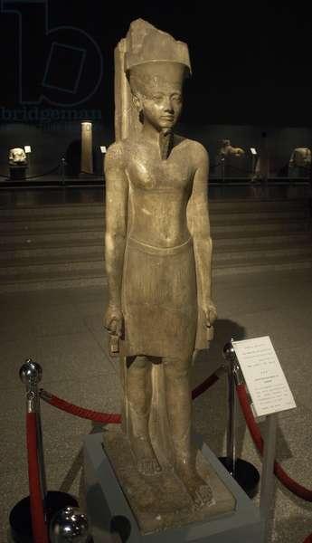Statue of god Amun with factions of the Pharaoh Tutankhamun. Egypt.