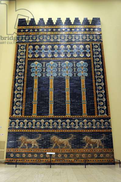 Mesopotamian art. Neo-Babylonian. The Throne Room of  Nebuchadnezzar II. Reconstructed facade. Dated in 580 B.C. Its 56 meters facade was decorated with colored glazed bricks as shows the composition, including stylized palms. The frieze of lions was presumably arranged symmetrically so that the animals faced toward the central main entrance to the trone-room. Pergamon Museum. Berlin. Germany.