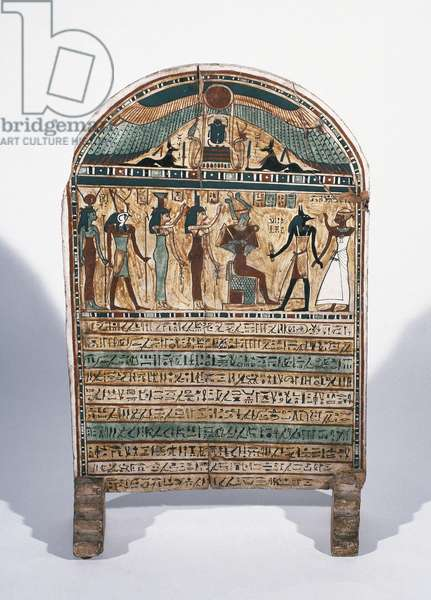 Painted wooden stele. The deseased before Osiris, Isis and Anubis. From Thebes