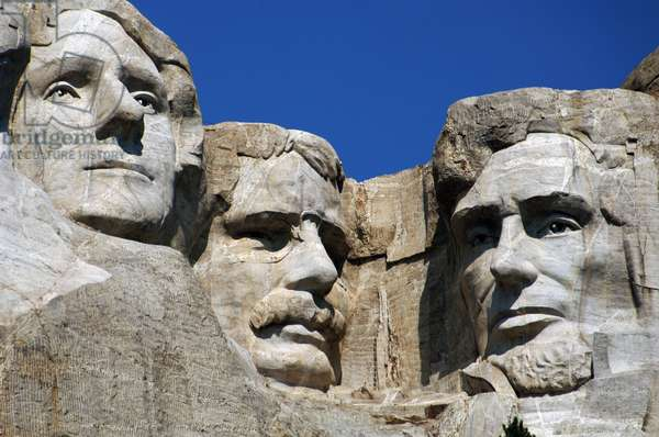 United States. Mount Rushmore National Memorial. Heads of the United States's presidents carved into Mount Rushmore. Detail. From left to right, Thomas Jefferson, Theodore Roosevelt and Abraham Lincoln. 1927-1941. By Gutzon and Lincoln Borglum. Keystone.