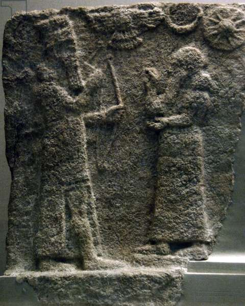 Neo-Assyrian Art, Gypsum tile from a domestic shrine depicting a man in Assyrian court dress that is worshipping a god, perhaps Ninurta