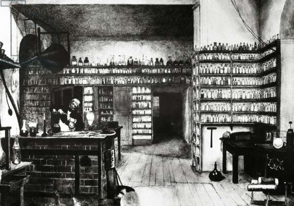 Michael Faraday (1791-1867) in his laboratory (engraving)
