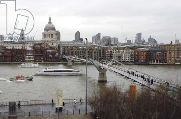 The Millennium Bridge over the River Thames with St. Paul's Cathedral in the background, London, UK (photo)