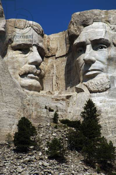 United States. Mount Rushmore National Memorial. Heads of the United States's presidents carved into Mount Rushmore. Detail. From left to right, Theodore Roosevelt and Abraham Lincoln. 1927-1941. By Gutzon and Lincoln Borglum. Keystone.