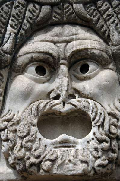 Ostia Antica. Roman theatrical mask on the stage of the Theatre. Marble. 1st - 2nd centuries BC. Italy.