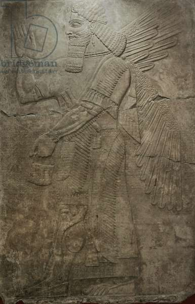 Assyria. Winged deity. Relief from the Palace of Ashurnasirpal II at Kalhu (Nimrud, Iraq).